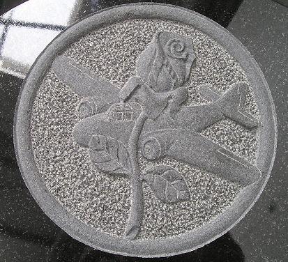Hand-carving on black granite by Burslem